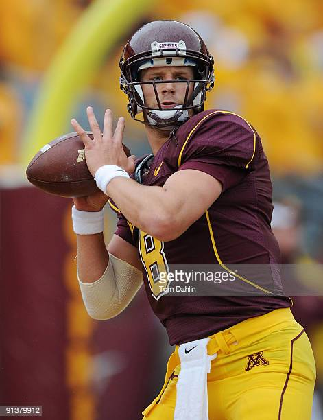 Adam Weber of the Minnesota Golden Gophers passes the ball during warmups in a NCAA football game against the Wisconsin Badgers on October 3 2009 at...