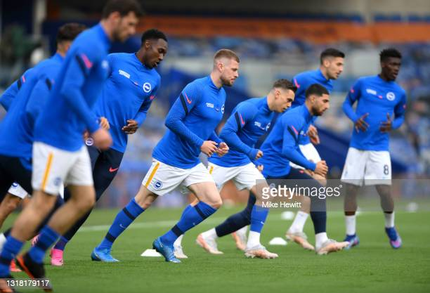 Adam Webster, Leandro Trossard and Danny Welbeck of Brighton and Hove Albion warm up prior to during the Premier League match between Brighton & Hove...
