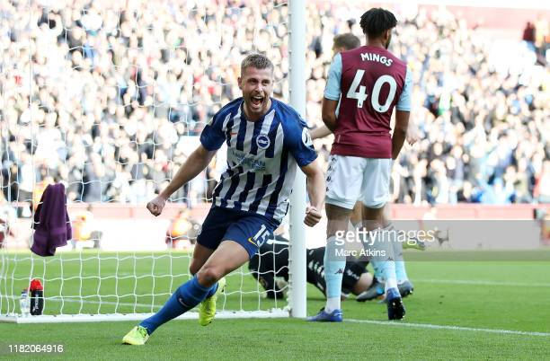 Adam Webster of Brighton and Hove Albion celebrates after scoring his team's first goal during the Premier League match between Aston Villa and...