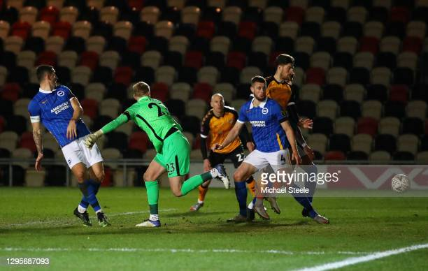 Adam Webster of Brighton and Hove Albion scores an own goal for Newport County's first goal during the FA Cup Third Round match between Newport...