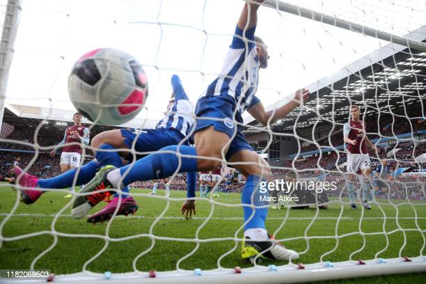 Adam Webster of Brighton and Hove Albion scores his team's first goal past Tom Heaton of Aston Villa during the Premier League match between Aston...