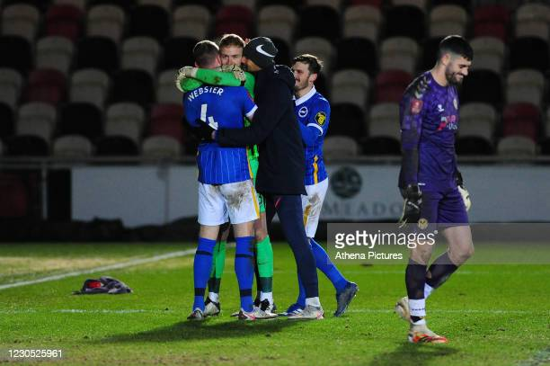 Adam Webster of Brighton & Hove Albion celebrates with his team mate Jason Steele at after scoring the winning penalty during the FA Cup Third Round...