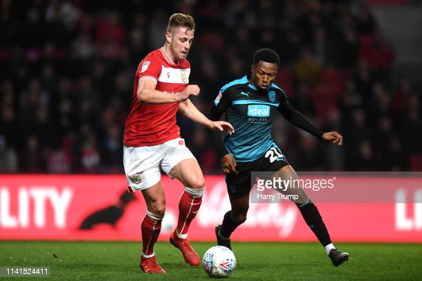 Adam Webster of Bristol City battles for possession with Kyle Edwards of West Bromwich Albion during the Sky Bet Championship match between Bristol...