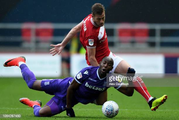 Adam Webster of Bristol City competes with Benik Afobe of Stoke City for the ball during the Sky Bet Championship match between Bristol City and...