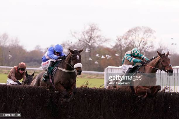 Adam Wedge rides King's Odyssey and clears the last to win The John Sumner Memorial Veterans' Handicap Chase at Warwick Racecourse on November 20...