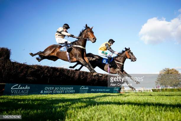 Adam Wedge riding Dark Invader clear the last to win The Smarkets Novices' Handicap Chase at Wincanton Racecourse on October 19 2018 in Wincanton...