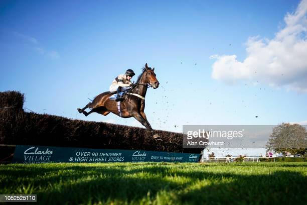 Adam Wedge riding Dark Invader on their way to winning The Smarkets Novices' Handicap Chase at Wincanton Racecourse on October 19 2018 in Wincanton...