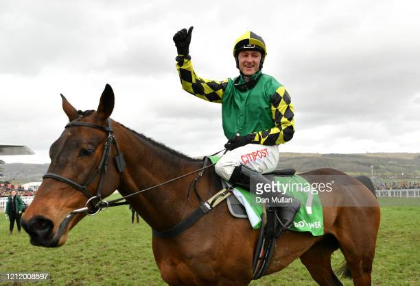 Adam Wedge riding Lisnagar Oscar celebrates winning the Paddy Power Stayers' Hurdle at Cheltenham Racecourse on March 12, 2020 in Cheltenham, England.