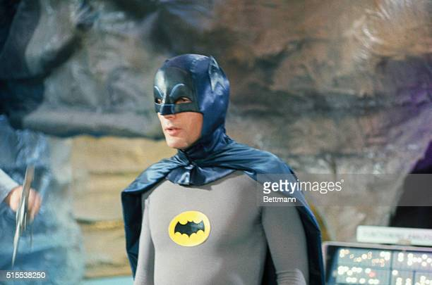 Adam West at Batman in costume during filming of one of the shows