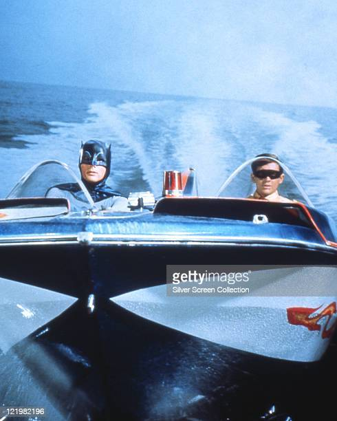 Adam West US actor and Burt Ward US actor both in costume as the 'Dynamic Duo' riding in the Batboat in a publicity still issued for the film...