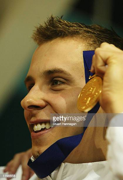 August 1: Adam Whitehead of England wins gold in the Men's 100M Breaststroke swimming final from the Manchester Aquatics centre during the 2002...