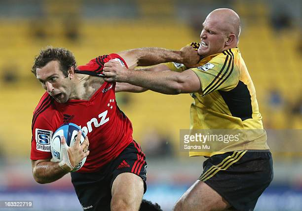 Adam Whitelock of the Crusaders is tackled by Ben Franks of the Hurricanes during the round four Super Rugby match between the Hurricanes and the...