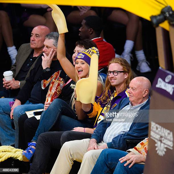 Adam Wichmann and Amalie Ny Wichmann attend a basketball game between the New York Knicks and the Los Angeles Lakers at Staples Center on March 12...