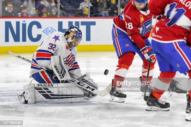 Adam Wilcox of the Rochester Americans about to make a save on a tip by Alexandre Grenier of the Laval Rocket at Place Bell on January 5 2019 in...