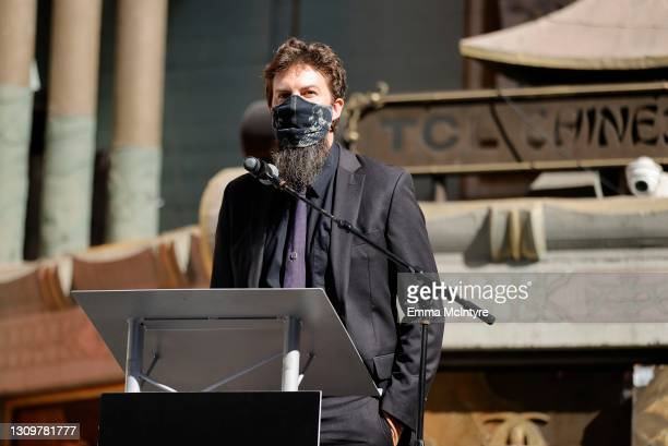 Adam Wingard speaks onstage during the post-pandemic reopening and ribbon cutting ceremony hosted by TCL Chinese Theatre on March 29, 2021 in...