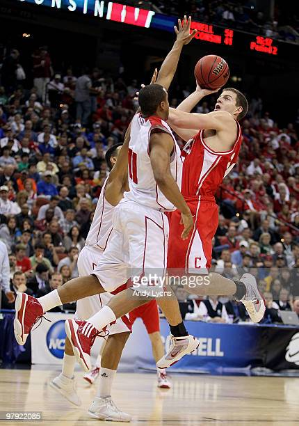 Adam Wire of the Cornell Big Red shoots over Jordan Taylor and Ryan Evans of the Wisconsin Badgers during the second round of the 2010 NCAA men's...