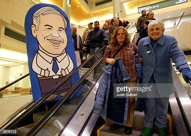 Adam Wirtzfeld of Minneapolis Minnesota wears a custom made 'Deanie Baby' costume as he rides the escalator to a rally appearance by Democratic...