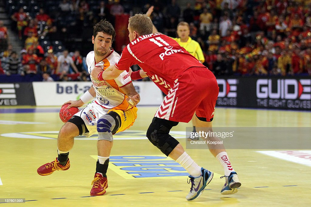 Adam Wisniewski of Poland (R) defends against Filip Mirkulovski of Macedonia (L) during the Men's European Handball Championship second round group one match between Poland and Macedonia at Beogradska Arena on January 23, 2012 in Belgrade, Serbia.