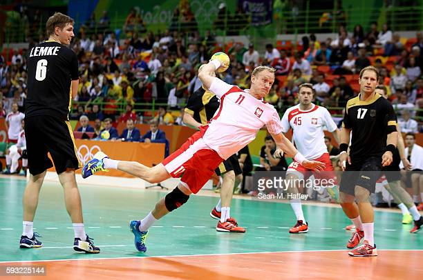 Adam Wisniewski of Poland takes a shot during the Men's Bronze Medal Match between Poland and Germany on Day 16 of the Rio 2016 Olympic Games at...