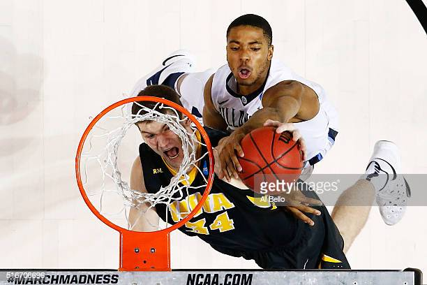 Adam Woodbury of the Iowa Hawkeyes goes up against Phil Booth of the Villanova Wildcats in the second half during the second round of the 2016 NCAA...