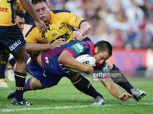 Adam Woolnough of the Knights crashes over for a try during the round one NRL match between the Newcastle Knights and the Parramatta Eels at Energy...