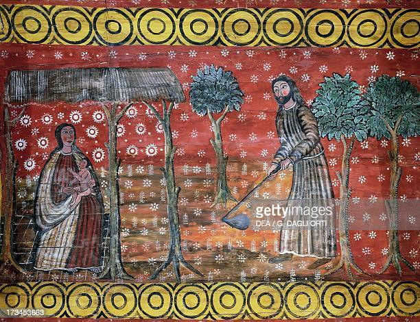 Adam working on the land while Eve breastfeeds Cain, Old Testament scenes, painted on wood , nave of Chapel St Gonery, Plougrescant, Brittany ,...