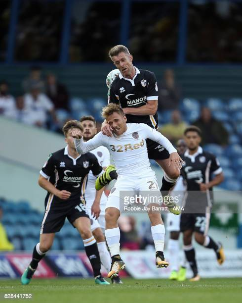 Adam Yates of Port Vale and Samuel Saiz of Leeds United during the Carabao Cup First Round match between Leeds United and Port Vale at Elland Road on...