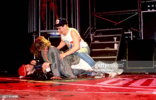 Adam Yauch and Adam Horovitz of the Beastie Boys perform a sex act with a woman during the Together Forever Tour on July 29 1987 at the Pine Knob...