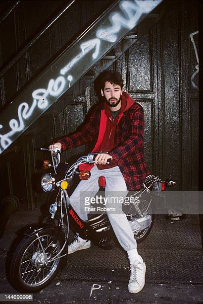 Adam Yauch of the Beastie Boys poses on a Suzuki moped in New York City on November 30th 1988. Yauch was also known by the stage name MCA.