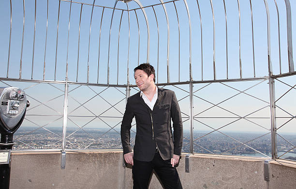 Owl City Visits The Empire State Building Photos and Images