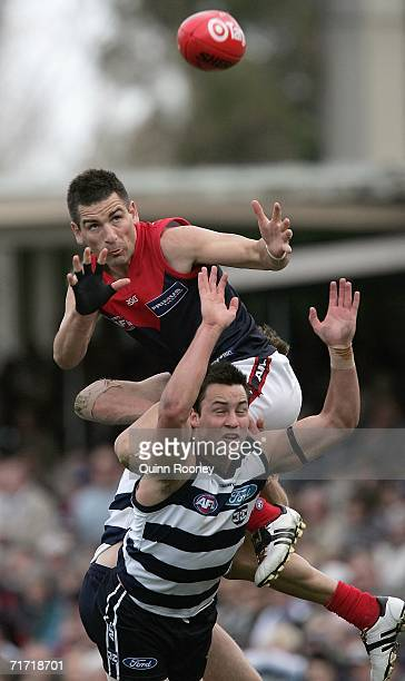 Adam Yze of the Demons flies for a mark on the boundary line during the round 21 AFL match between the Geelong Cats and the Melbourne Demons at...