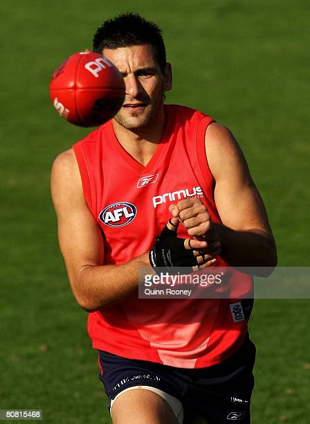 Adam Yze of the Demons handballs during a Melbourne Demons AFL training session at Junction Oval on April 22 2008 in Melbourne Australia