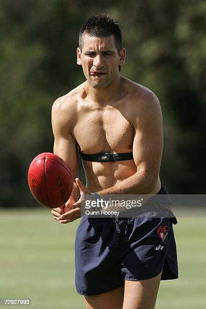Adam Yze of the Demons handballs during a Melbourne Demons training session at Trinity Sports Field on January 5 2007 in Melbourne Australia
