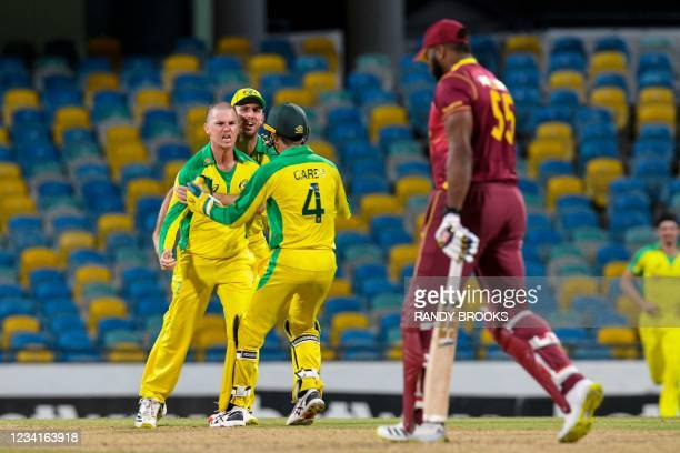 Adam Zampa and Mitchell Marsh of Australia celebrate the dismissal of Kieron Pollard of West Indies during the 2nd ODI between West Indies and...