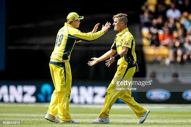 Adam Zampa and Steve Smith of Australia celebrate the wicket of Kane Williamson of New Zealand during game two of the one day international series...