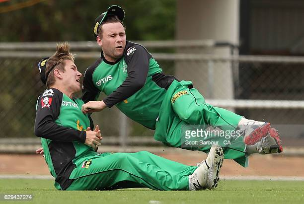 Adam Zampa and Tom Triffitt of the Stars collide in the outfield as Adam Zampa takes a catch during the Twenty20 Border Bash match between the...