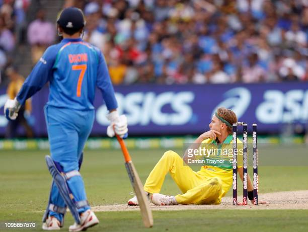 Adam Zampa of Australia attempts to run out MS Dhoni of India during game three of the One Day International series between Australia and India at...