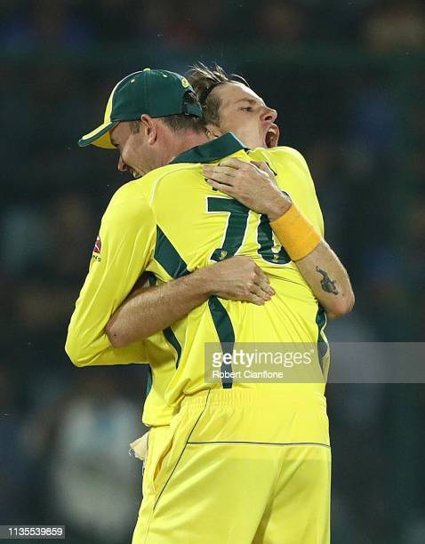 Adam Zampa of Australia celebrates taking the wicket of Rohit Sharma of India during game five of the One Day International series between India and...