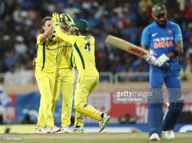 Adam Zampa of Australia celebrates taking the wicket of Virat Kohli of India during game three of the One Day International series between India and...
