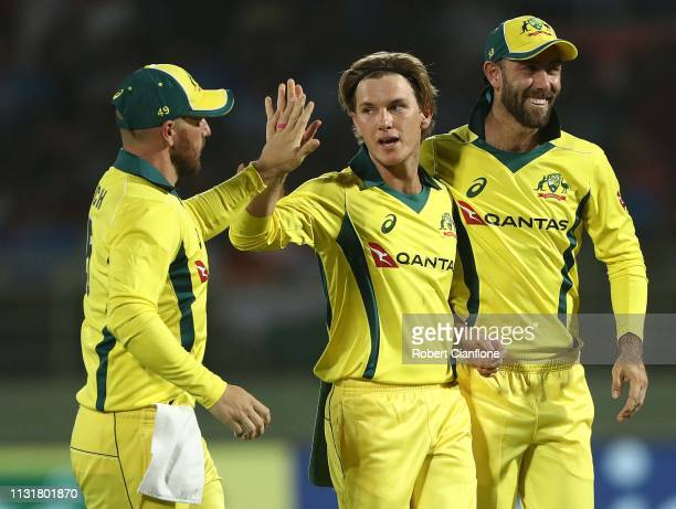 Adam Zampa of Australia celebrates with Aaron Finch and Glenn Maxwell after taking the wicket of Virat Kohli of India during game one of the T20I...