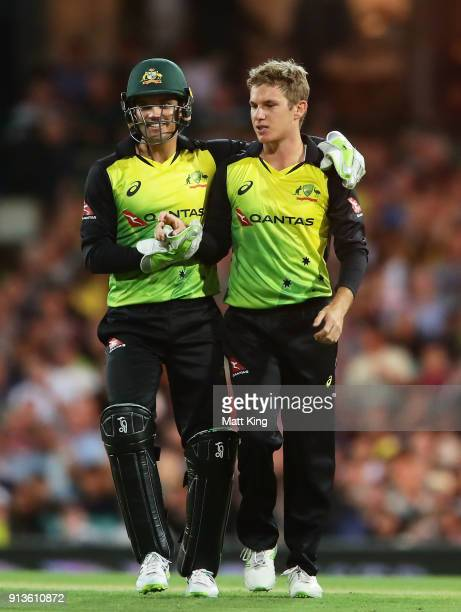 Adam Zampa of Australia celebrates with Alex Carey of Australia after taking the wicket of Tom Blundell of New Zealand during game one of the...