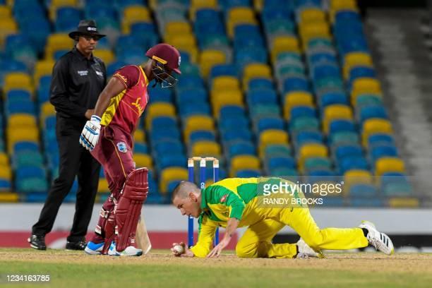Adam Zampa of Australia fields as Nicholas Pooran of West Indies stays in his crease during the 2nd ODI between West Indies and Australia at...