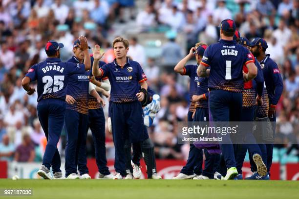 Adam Zampa of Essex celebrates with his teammates after dismissing Aaron Finch during the Vitality Blast match between Surrey and Essex Eagles at The...