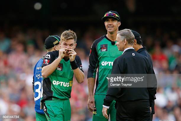 Adam Zampa of the Melbourne Stars looks up at a replay where he was struck in the face by the ball in a run out during the Big Bash League match...