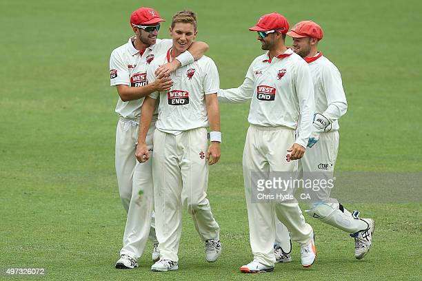 Adam Zampa of the Redback celebrates with team mates after dismssing James Hopes of the Bulls during day three of the Sheffield Shield match between...