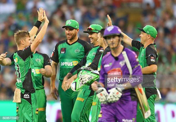 Adam Zampa of the Stars is congratulated by his teammates after dismissing George Bailey of the Hurricanes during the Big Bash League match between...