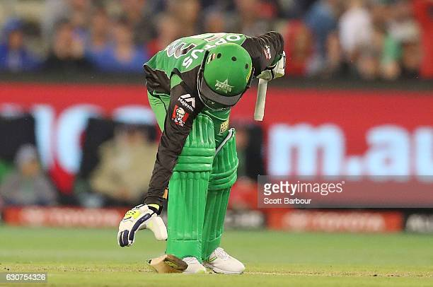 Adam Zampa of the Stars picks up his broken bat after being run out during the Big Bash League match between the Melbourne Stars and Melbourne...