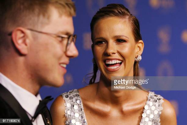 Adam Zampa speaks to media as partner Harriet Palmer reacts at the 2018 Allan Border Medal at Crown Palladium on February 12 2018 in Melbourne...