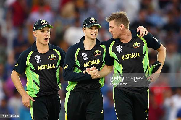 Adam Zampa Steve Smith and James Faulkner of Australia celebrate victory during the ICC WT20 India Group 2 match between Pakistan and Australia at IS...