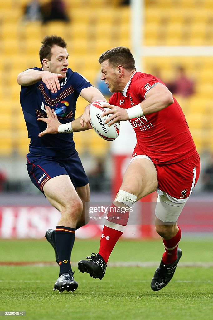 Adam Zaruba of Canada beats the tackle of Nyle Godsmark of Scotland in the Bronze Final match between Scotland and Canada during the 2017 Wellington Sevens at Westpac Stadium on January 29, 2017 in Wellington, New Zealand.